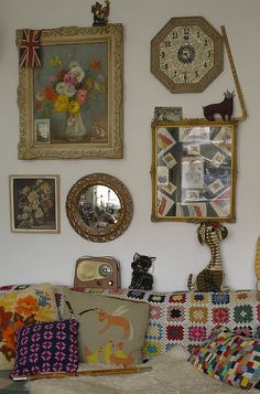 secondhand finds at their eclectic best. hows that radio, the tapesty cushion, the floral artworks and the crochet blanket. i heart this look.