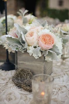 Soft wedding centerpiece with dusty miller and blush peonies.