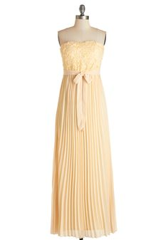 Dream of Buttercream Dress. Wearing the chiffon rosettes and accordion pleats of this graceful maxi dress is just as sweet as you envisioned it would be! #cream #prom #modcloth