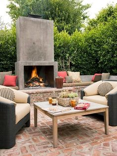 cement and brick masonry combined with deep cushion seating and colorful outdoor pillows create a perfect gathering spot by krista