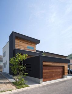 Inspirational M4 House In Black And Brown Scheme Of Wood Seen From Street Side With Refreshing Tree Growing Next To It