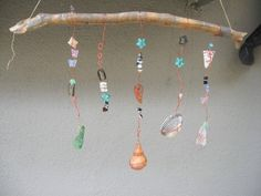 Make simple suncatchers with your collected stones, sea glass, and shells.