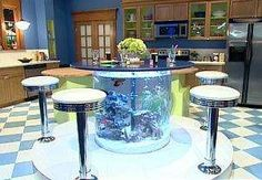 Fish tank table...ok this is a must. What a conversation piece! Not big on those stools they would have to be eliminated
