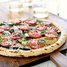 You can use all zucchini or yellow squash for this grilled pie. Serve one slice as an appetizer or two with a salad for a simple supper.