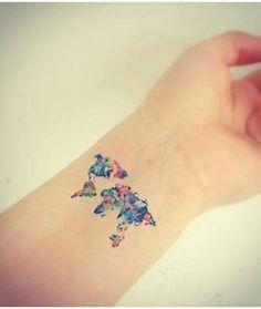 wrist colorful map tattoo