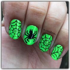 Day 1 for #clairestelle8halloween is Spiders 🕷 I used Spoiled by @wetnwildbeauty I'm So Jaded with @sally_hansen Black Out. Spider was made using a doting tool and the webs were stamped using Cheeky Jumbo Plate 6 Happy Holidays then topped with @glistenandglow1 #hkgirltopcoat #glistenandglow #wetnwildbeauty #sallyhansen #neonnails #spidernails #halloweennails
