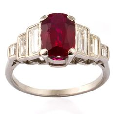 An Art Deco ruby and diamond ring, 1920s The cushion-shaped ruby, weighing 1.91 carats, set between stepped baguette-cut diamond shoulders, ruby is likely to be of early 19th century cut, diamonds approximately 0.80 carat total, mounted in platinum