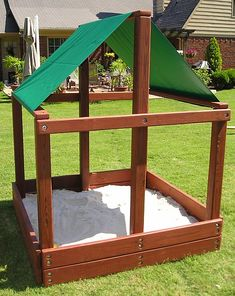I wonder if I could convince Adam to build us something like this for the backyard this summer... but it would need a cover.  And I think I would fill it with just dirt and maybe we could enclose the sides with something cheap like plastic trellis and put a water table in there.  Messy but super fun!
