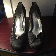 Jeweled bow pumps Black, in excellent condition. Worn once. Shoes Heels