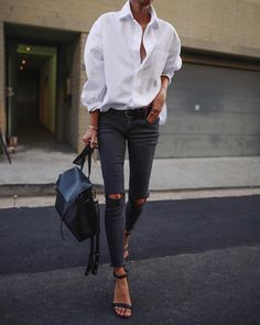 Combination of the oversized shirt with the distressed jeans & belt; colors
