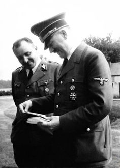 This is Martin Bormann with Hitler in August, 1940. Roehm had been dead here 6 years. :) (via putschgirl)