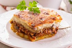 Hearty and tasty dish - Greek moussaka with eggplant and minced meat Sauce Recipes, Cooking Recipes, Cypriot Food, Macedonian Food, Greek Dishes, Comfort Food, Tzatziki, Greek Recipes, Antipasto