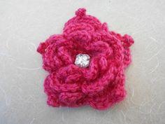 Handcrocheted pink flower brooch with a diamond by saivijayanaidu, $8.00