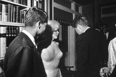 Marilyn Monroe and Bobby Kennedy (left) fought the day she died (Speaking to John F Kennedy)