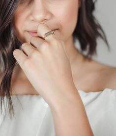 "Ingrid Nilsen x Mejuri limited edition. Gold vermeil ""Choices"" flipping ring engraved on one side"