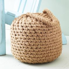 Our Harborside Buoy Ottoman is hand crafted from jute, lending a boat-like feel to any room | domino.com