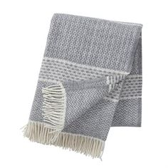 Quilt wool throw by the family business Klippan Yllefabrik is designed by Birgitta Bengtsson Björk. The throw has a classic look with traditional patterns and decorative fringes. It's made of 100% lambs wool of highest quality and is extremely soft and comfy. Perfect to wrap yourself in during chilly evenings in the sofa!
