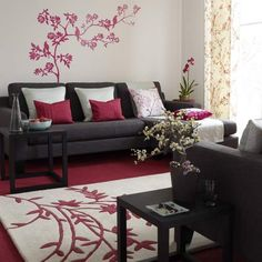 Oriental-style living room - love the dark charcoal grey coach with the pop of raspberry reddish pink.