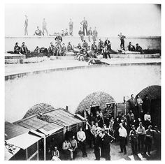 Union soldiers captured at Bull Run in the courtyard of Castle Pinckney, Charleston Harbor, with guards above, 1861. Click twice on the image for some facinating detail...