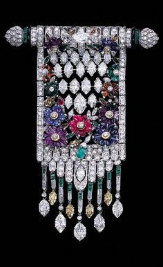 Bar pendant with marquise- and round-cut diamonds and carved ruby, emerald, sapphire, amethyst and citrine flowerheads circa 1930