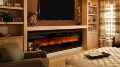 Is an Electric Fireplace Worth the Money? | Angie's List Electric Fireplace Entertainment Center, Large Entertainment Center, Built In Electric Fireplace, Electric Fireplaces, Entertainment Room, Entertainment System, Wall Units With Fireplace, Fireplace Tv Stand, Fireplace Wall