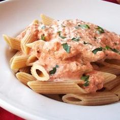 Tomato-Cream Sauce for Pasta - Can't remember the last time I cooked dinner on a weeknight, but I did tonight. Made the tomato sauce ahead on the weekend, then warmed it and added the cream tonight while I cooked the pasta. The kids loved this.