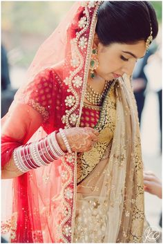 A traditional Indian bride prepares for her Hindu wedding ceremony. Indian Wedding Bride, Hindu Wedding Ceremony, Desi Wedding, Saree Wedding, Wedding Attire, Indian Weddings, Wedding Ideas, Wedding Dresses, Indian Bridal Outfits