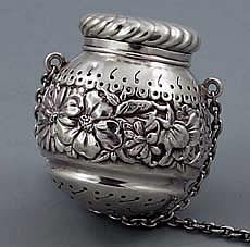 """Gorham Repousse Sterling Silver Tea Ball    A large antique sterling silver tea ball by Gorham circa 1890 with fine piercing and a wide chased band of decoration around the center. 1 7/8"""" long."""