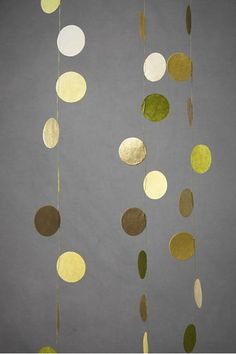 Textured gold circles in this DIY party garland have just the right amount of understated sparkle.