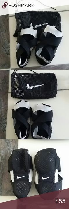 Nike Studio Wrap Never been used, black and gray Nike Studio Wrap.  Grip bottoms and very stretchy.   Great for yoga, Pilates, barre, etc. Nike Shoes Athletic Shoes