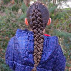 Half up style with hair wrapped around the elastic into a five strand Dutch braid.