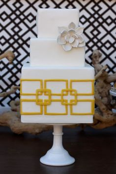 Modern yellow square and rectangle cake. A lily would be a more appropriate flower for Art D/N.