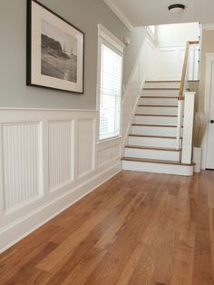 Spaces Wainscoatting Design, Love the wood floors, steps, and wall trim work.