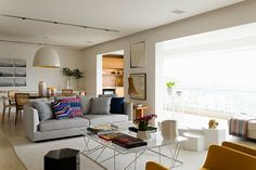 Spacious and airy living space of the stylish Brazilian home Posh Apartment In Brazil Captivates With Smart Accents Of Yellow And Green