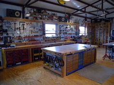 Shop organization. Work bench in middle with storage all around...