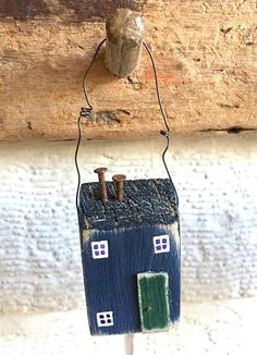 This door decoration is an adorable little house which I have made into a hanging house using recycled wood. This door hanger or wall hanging makes a cute Fathers Day gift or general gift for Dad that would brighten up his office or shed or even his mancave! These cute hanging houses are