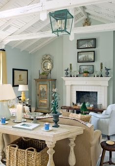 love this room--can stare at it for a long time.  The painted cupboard in corner is so fetching.  Artwork arrangement above mantle, charming.  Wish I could see sofa front.    Living Areas @ Cathy Kincaid Interiors