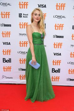 Easy being green: Dakota Fanning dazzled literally and figuratively at the Toronto International Film Festival premiere of her new film American Pastoral on Friday