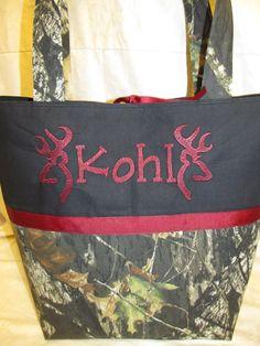 Handmade mossy oak camo camouflage black burgundy browning inspired buck deer diaper bag / tote bag  you choose name. $49.99, via Etsy.