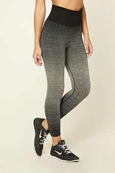 A pair of capri leggings with a gradated stripe print, moisture management, and a contrast ribbed waist.