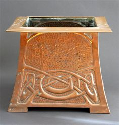 A Scottish copper jardiniere by Margaret Gilmour, flaring square section, repousse decorated with Celtic knot motif unsigned 26cm. high