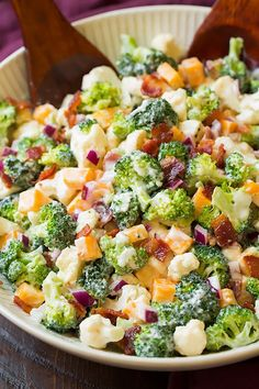 Broccoli never tasted so good! Raw broccoli can be totally boring but when you toss it into a salad with cheese and bacon incredible things just happen! I'm a huge fan of coleslaw dressing type salads so
