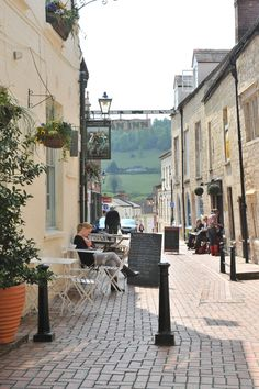 Stroud - Cotswolds. That is one pretty photo but I'm not sure you can see that view down that street and I was born there. . .