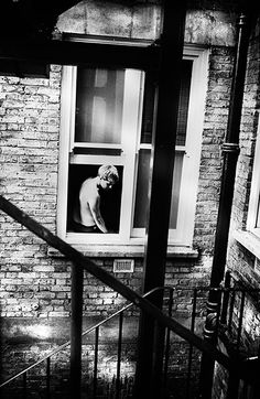 """London 238   Petersen describes his way of looking as being imbued with """"a kind of poetic sadness"""". You can detect this, too, in his Soho pictures: in the people he chose to photograph, the places he visited on his night-time wanderings and the way he uses graininess and high-contrast tones to accentuate his essentially melancholy vision"""