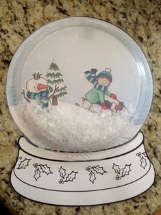 Snow Globe Craft by sashamommy. This was a craft I did for our MOMS Club Winter Party. I used my Silhouette Cameo to cut out the sleds, snowmen and trees, and the kids used glue sticks to paste them on. Then we put a pile of fake snow in the middle and glued a clear plastic plate to the top.