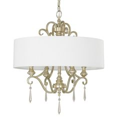This Ansley Park Collection 4-light chandelier features a beautiful hand painted iced gold finish that will complement many transitional and traditional decors. The white fabric shade softens the light while the crystal accents add interest to this piece.