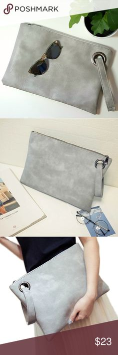 """Faux Leather Envelope Clutch NWT Cool and cute gray vegan leather clutch with side strap. Brand new with dust bag. Two pockets and one zippered pouch inside. Measures 12.5"""" by 8.5"""". Large enough to fit phone, wallet, keys, and more. Great for travel. Bags"""