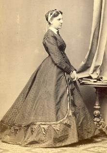 c. 1865 Day dress with fullness to the back; CDV.
