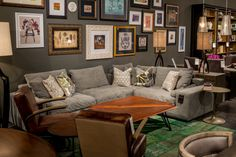 Four Hands, Las Vegas Market, Jan 2014 – Gallery Art, Gray Sofa, Leather Chairs, Wood Coffee Table, Brass Side Table