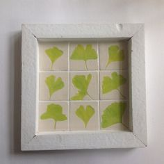 9 ceramic tiles in a white wooden frame leaves door HollandCeramics